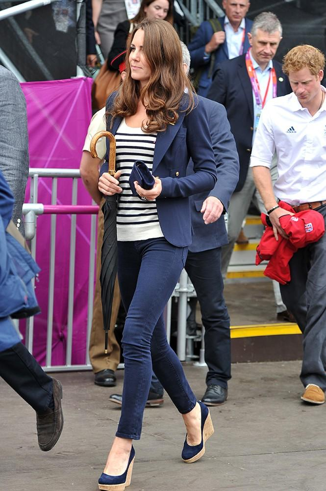 The Olympics took London by storm, and the young royals weren't going to miss it. Kate sported UK colors in this striped top and navy jeans.