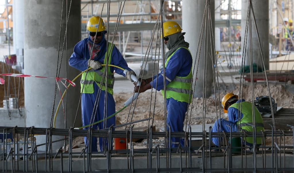 Migrant labourers are seen working on a construction site in Doha, Qatar (AFP Photo/Karim Jaafar)