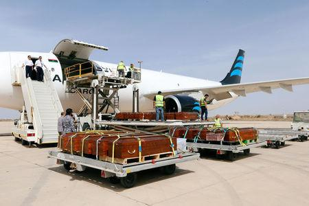Coffins containing the remains of the bodies of Egyptian Copts killed by Islamic State militants in Sirte are loaded to the plane to be transferred to Egypt, in Misrata, Libya May 14, 2018. REUTERS/Ismail Zitouny