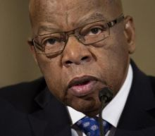Trump continues railing against John Lewis
