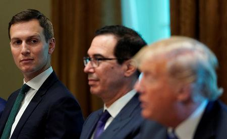 U.S. President Donald Trump, seated with White House senior adviser Jared Kushner (L) and Treasury Secretary Steve Mnuchin (C), speaks during his meeting with the Emir of Kuwait Sheikh Sabah al-Ahmad al-Jaber al-Sabah at the White House in Washington, U.S., September 5, 2018. REUTERS/Kevin Lamarque