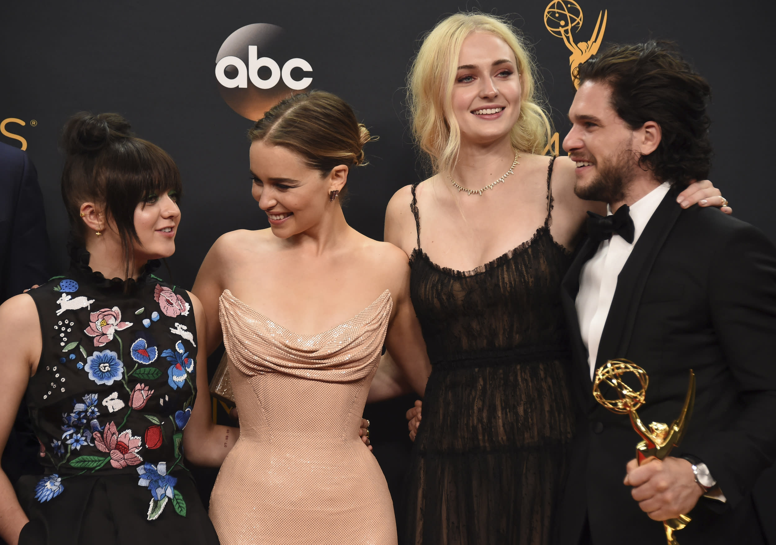 """Maisie Williams, from left, Emilia Clarke, Sophie Turner, and Kit Harington winners of the award for outstanding drama series for """"Game of Thrones"""" pose in the press room at the 68th Primetime Emmy Awards on Sunday, Sept. 18, 2016, at the Microsoft Theater in Los Angeles. (Photo by Jordan Strauss/Invision/AP)"""