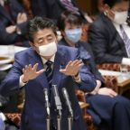 Japan expands ban on visitors as virus cases climb