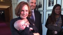 B.C. energy minister Michelle Mungall takes seat in legislature with baby Zavier
