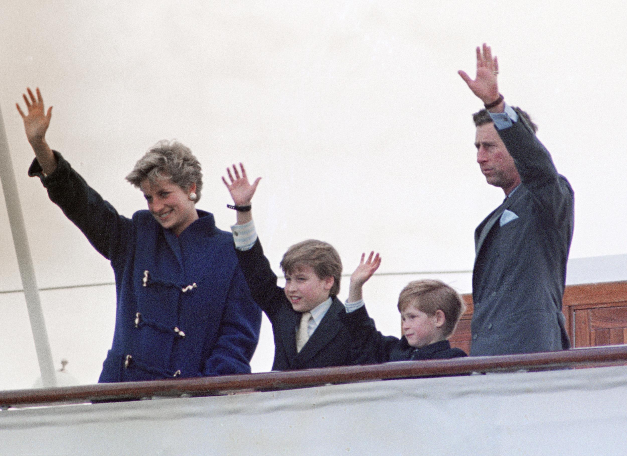 The Prince and Princess of Wales and their two children, Prince William, 9, and Prince Harry, 7, wave goodbye from the deck of the Royal Yacht Britannia to the people of Toronto at the end of the Royal couple's five-day official visit to the city.