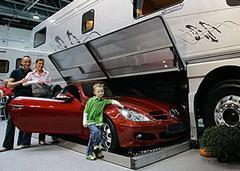 The RV with a slide-out roadster hold