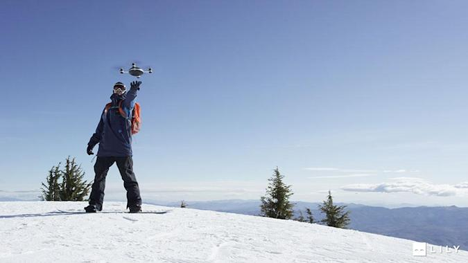 This drone follows you down the trail after you toss it up in the air