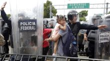 Migrant Caravan Begins To Cross Into Mexico From Guatemala
