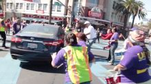 Frightening moment man tries to drive through a protest in California