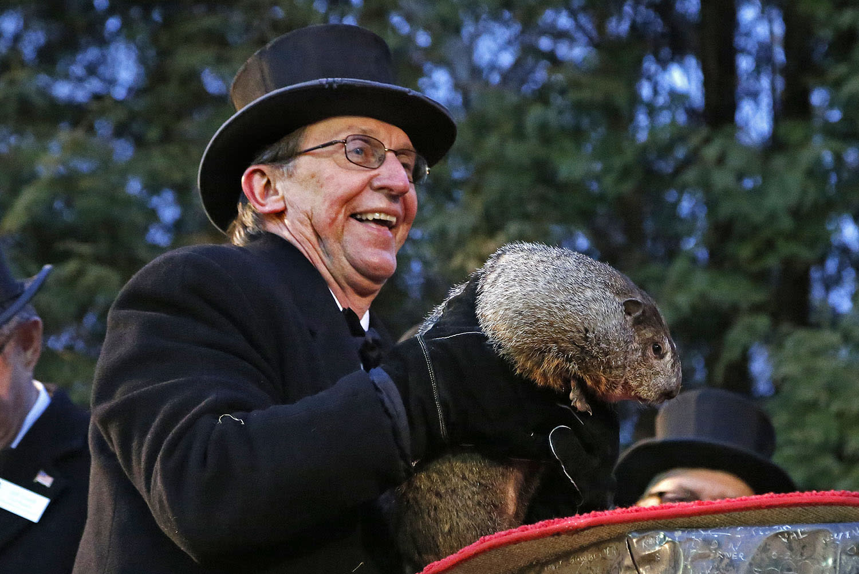 <p>Groundhog Club handler Ron Ploucha holds Punxsutawney Phil, the weather prognosticating groundhog, during the 131st celebration of Groundhog Day on Gobbler's Knob in Punxsutawney, Pa., Feb. 2, 2017. (AP Photo/Gene J. Puskar) </p>