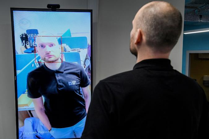 Nikolai Grunin, an employee at NtechLab, the company that won the city's tender to supply the facial recognition technology, demonstrates the technology during an interview with AFP on February 5, 2020. - A vast and contentious network of facial-recognition cameras keeping watch over Moscow is now playing a key role in slowing the rapid spread of coronavirus in Russia. (Photo by Kirill KUDRYAVTSEV / AFP) (Photo by KIRILL KUDRYAVTSEV/AFP via Getty Images)