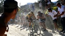 Van Aert triumphs as cycling returns in Strade Bianche's heat and dust