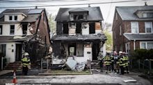 The Latest: Fire marshals begin fatal blaze investigation