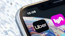 Uber, Lyft suspend services amid protests