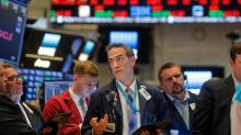 Shares edge up after Fed rate cut, oil prices gain