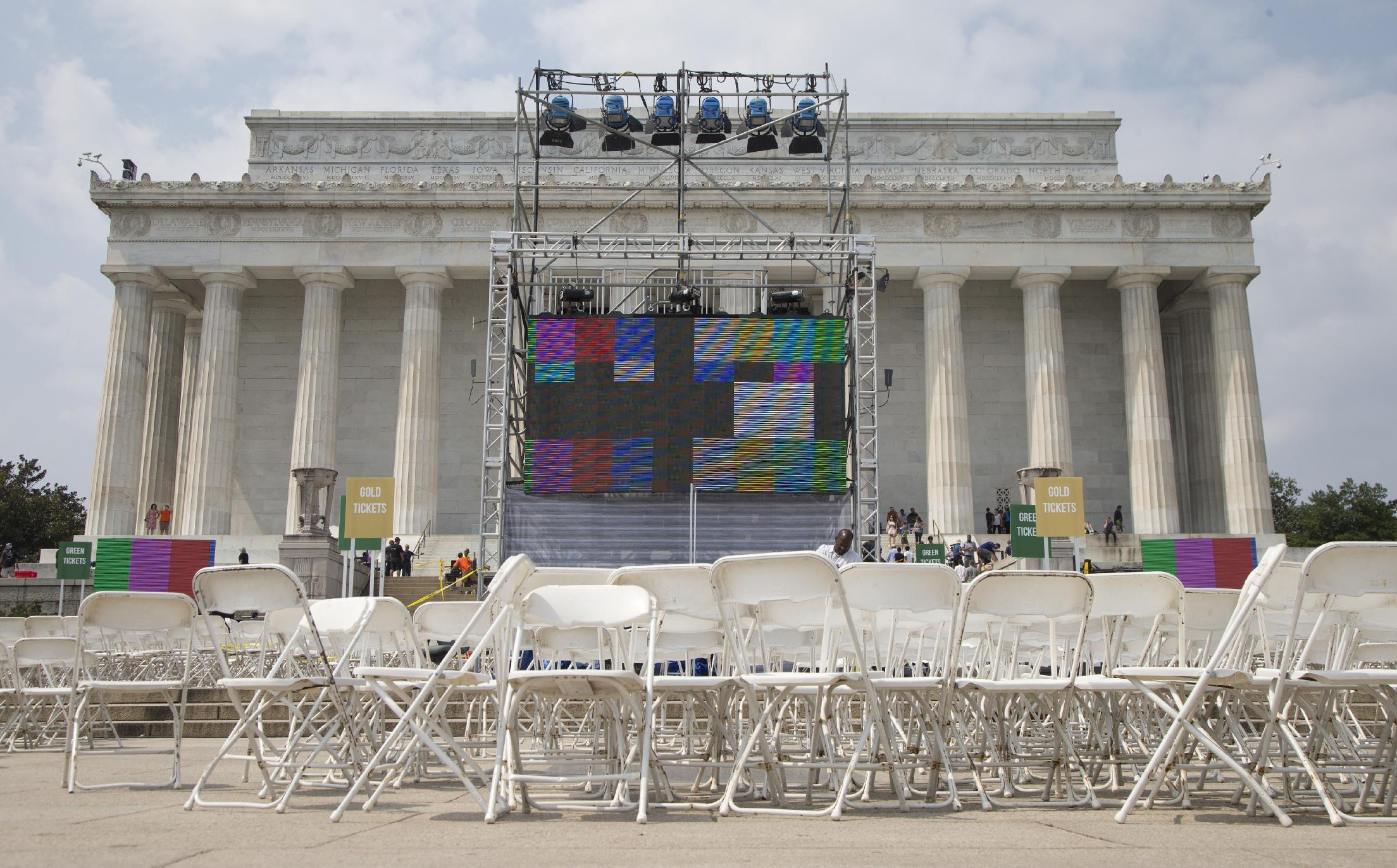 """Chairs, metal risers and video screens are set up at the Lincoln Memorial in Washington, Tuesday, Aug. 27, 2013, in preparation for the 50th anniversary of the March On Washington celebrations that will be held Wednesday, Aug, 28, 2013. Barack Obama, who is going to speak, was 2 years old and growing up in Hawaii when Martin Luther King Jr. delivered his """"I Have a Dream"""" speech from the steps of the Lincoln Memorial. Fifty years later, the nation's first black president will stand as the most high-profile example of the racial progress King espoused, delivering remarks at a nationwide commemoration of the 1963 demonstration for jobs, economic justice and racial equality. (AP Photo/Carolyn Kaster)"""