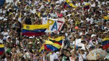 Venezuela's Guaido defies travel ban as aid row turns deadly