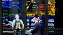 ASX hits new high as Aussie dollar sinks