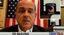 NYPD union chief appears on Fox News with far-right conspiracy theory QAnon symbol in background