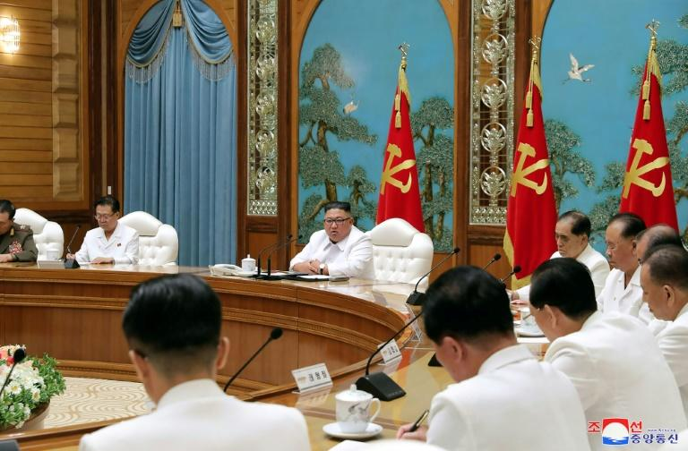 North Korean leader Kim Jong Un convened an emergency politburo meeting on Saturday to implement a 'maximum emergency system and issue a top-class alert' to contain the virus, official news agency KCNA said