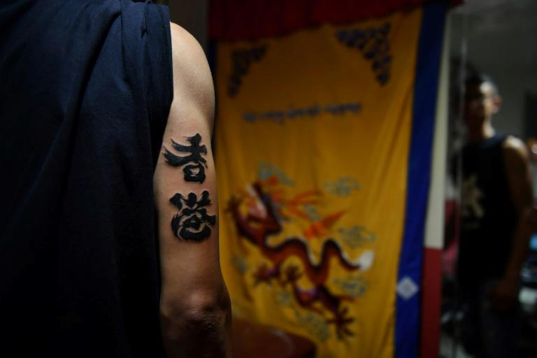 Tattoo studios in Hong Kong have received a surge in requests for protest-related artworks (AFP Photo/Lillian SUWANRUMPHA)