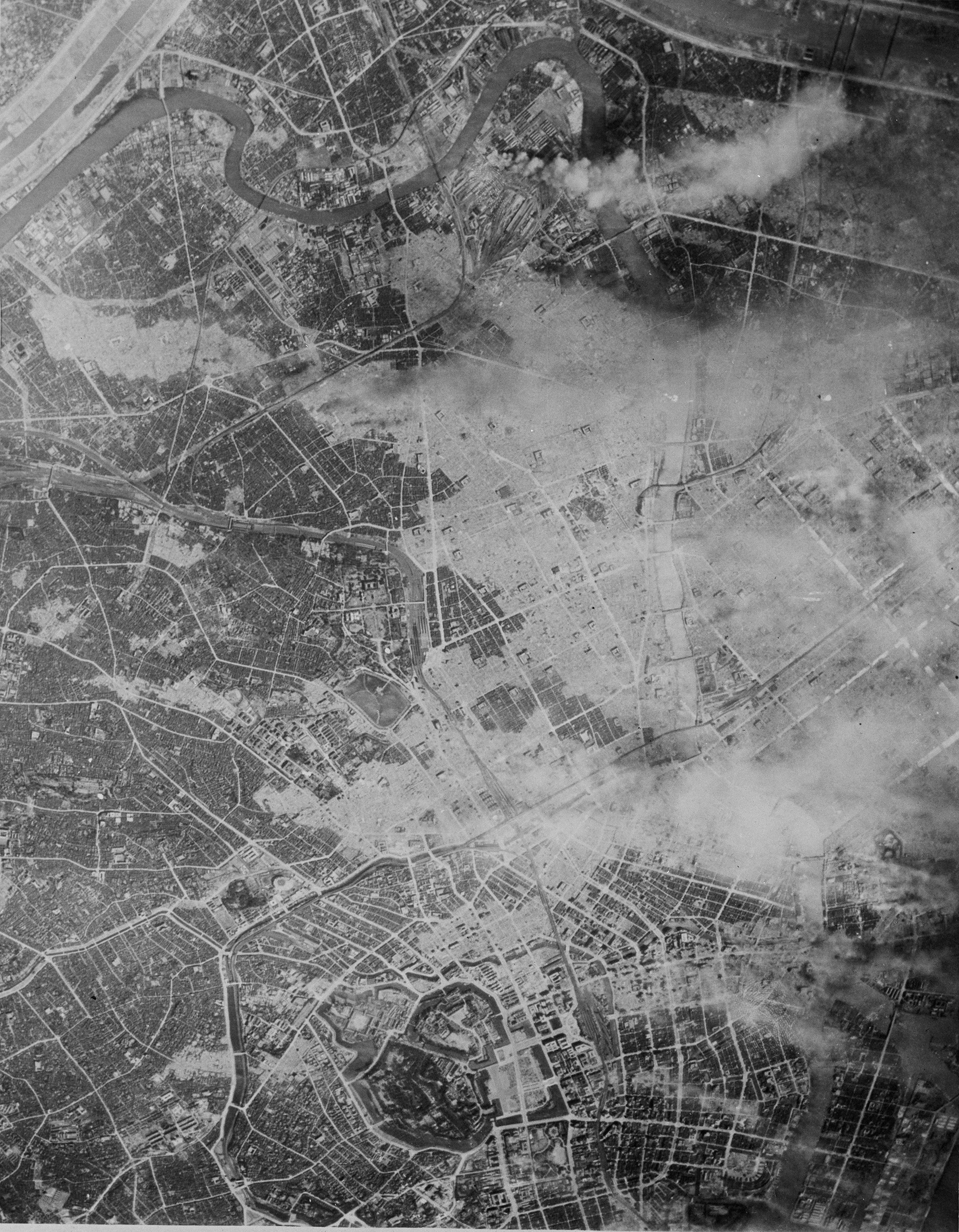 FILE - This March 10, 1945, file photo shows light sections, still smoking, several hours after a raid by more than 300 Marianas-based B-29s on Tokyo. The Imperial Palace, upper center, was undamaged, but burned up to the edge of the grounds. The bombs stopped falling 75 years ago, but it is entirely possible - crucial even, some argue - to view the region's world-beating economies, its massive cultural and political reach and its bitter trade, territory and history disputes all through a single prism: Japan's aggression in the Pacific during World War II. (AP Photo)