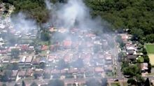 Home burnt by bushfire amid 40C heatwave and 90km/h winds