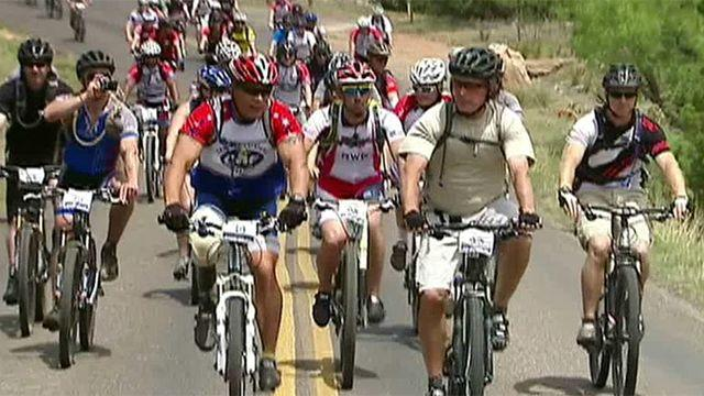 President Bush bikes with Wounded Warrior