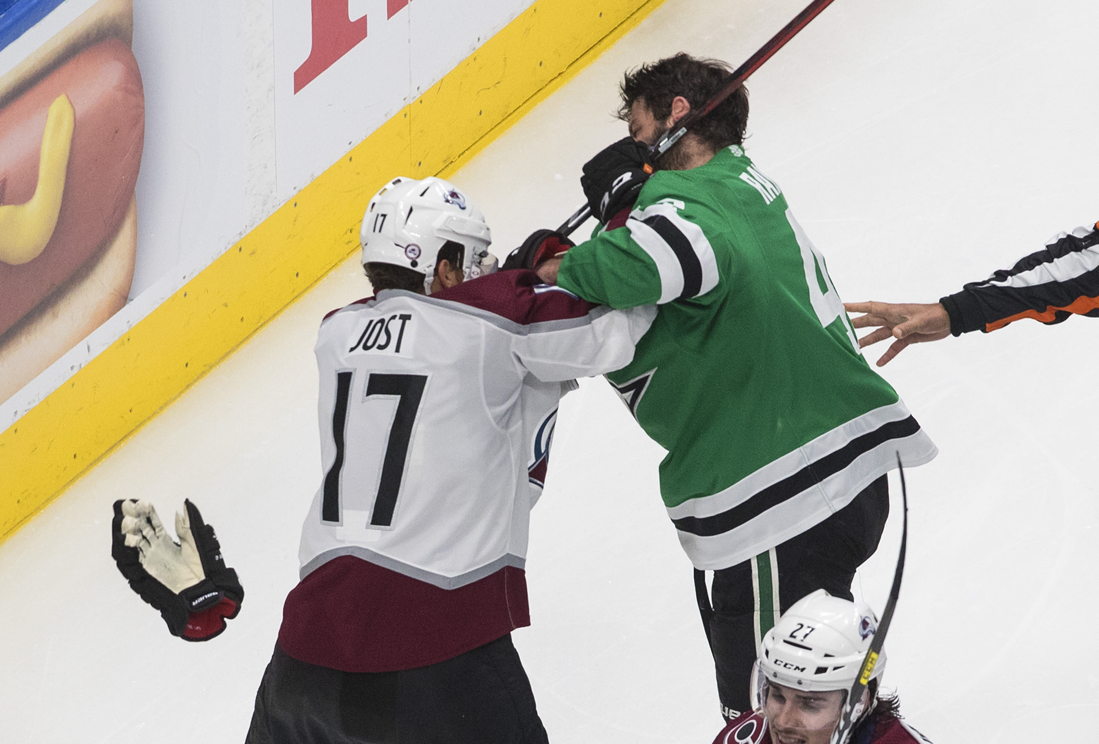 Dallas Stars' Alexander Radulov (47) and Colorado Avalanche's Tyson Jost (17) tussle during the third period of Game 3 of an NHL hockey second-round playoff series, Wednesday, Aug. 26, 2020, in Edmonton, Alberta. (Jason Franson/The Canadian Press via AP)
