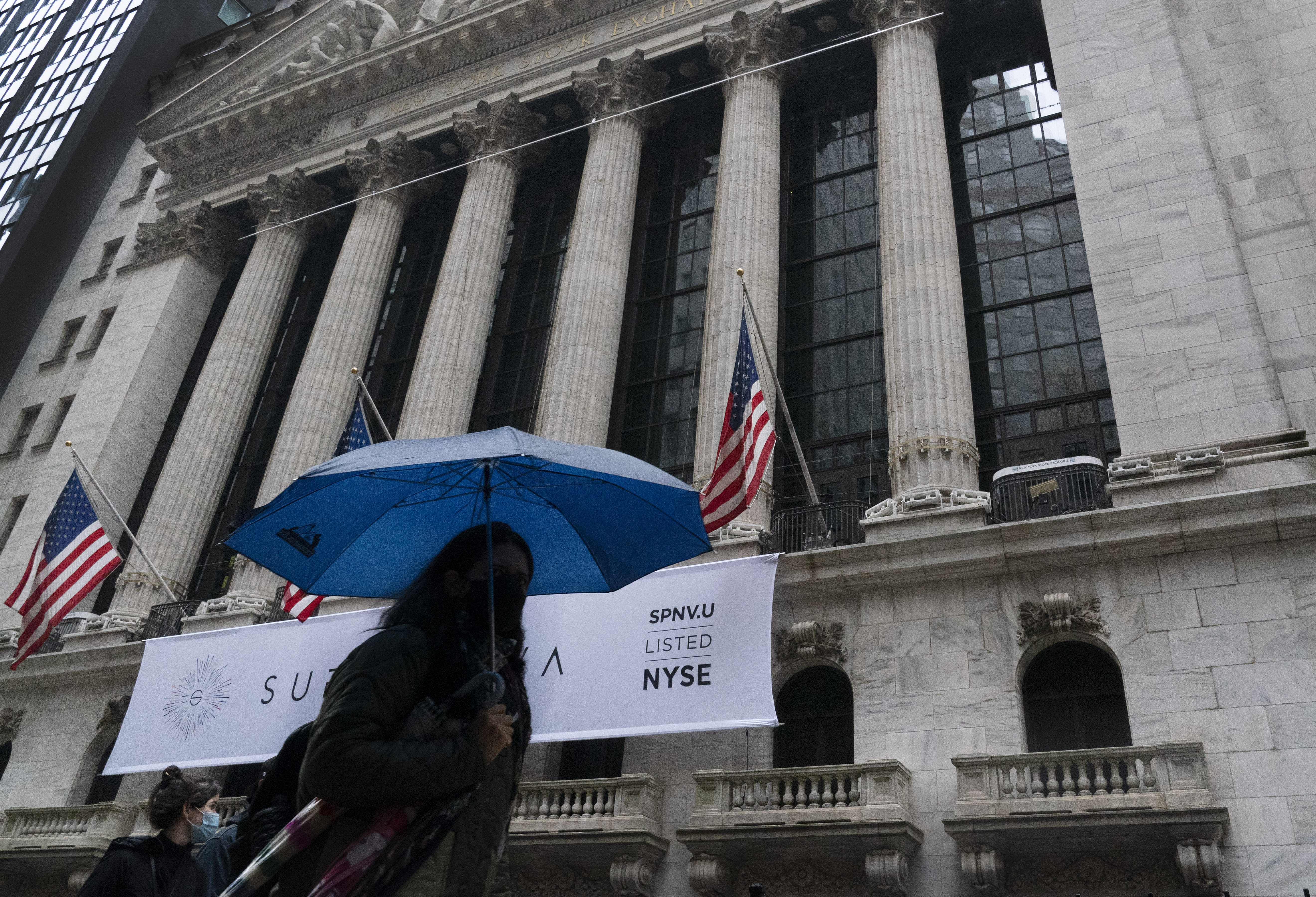 Wall Street scuffles as worsening pandemic slows its rally