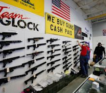 A federal appeals court blocked a judge's ruling that would throw out California's assault weapon ban