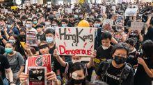 Asian markets rise as Hong Kong airport resumes flights after night of chaos