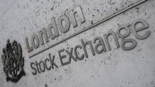 Stocks sink on dismal economic data, mixed trade signals