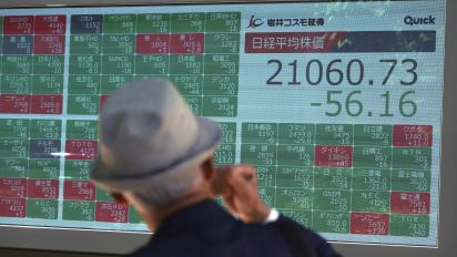 Asian shares mixed as investors look to Fed rates