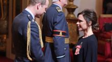 Victoria Beckham cracks a smile and shuns a hat as she receives OBE from Prince William
