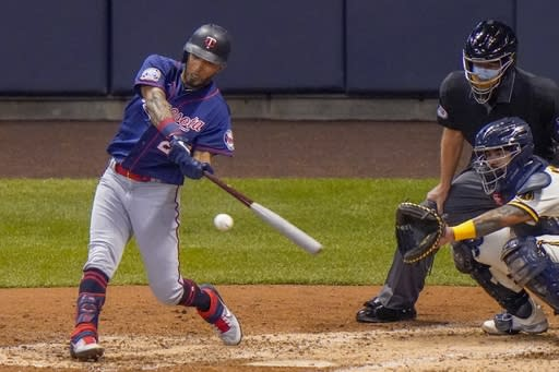 Minnesota Twins' Eddie Rosario hits a single during the fifth inning of a baseball game against the Milwaukee Brewers Monday, Aug. 10, 2020, in Milwaukee. (AP Photo/Morry Gash)
