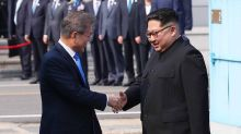 North Korean Leader Kim Jong-un and President Moon Jae-in Shake Hands at Historic Summit