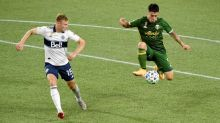 Defender/midfielder Andy Rose re-signs with Vancouver Whitecaps