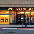 Wells Fargo will cut costs further after first loss since 2008