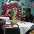 Inmates at Chowchilla Women's Correctional Facility meet with families and exchange gifts