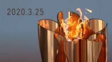 Olympic flame removed from public view amid postponed Tokyo Games