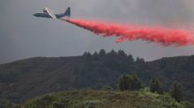 Firefighters gain on deadly California blaze, some evacuees to return