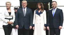 Melania Trump steps out in $5K designer coat to greet Poland's first couple