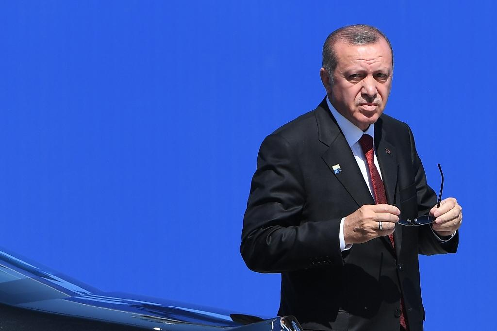Turkish President Recep Tayyip Erdogan has lashed out at a US trial in which he has been implicated in a multi-billion-dollar gold-for-oil scheme (AFP Photo/Emmanuel DUNAND)
