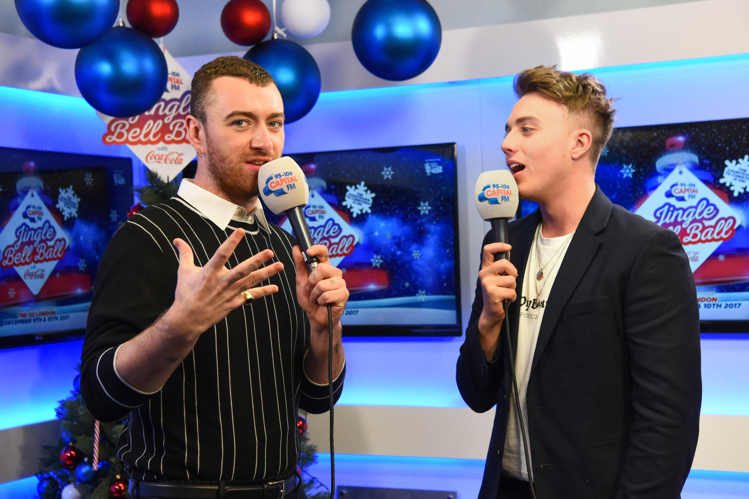 Sam Smith is interviewed backstage by presenter Roman Kemp during day one of Capital's Jingle Bell Ball 2017 at the O2 Arena, London.