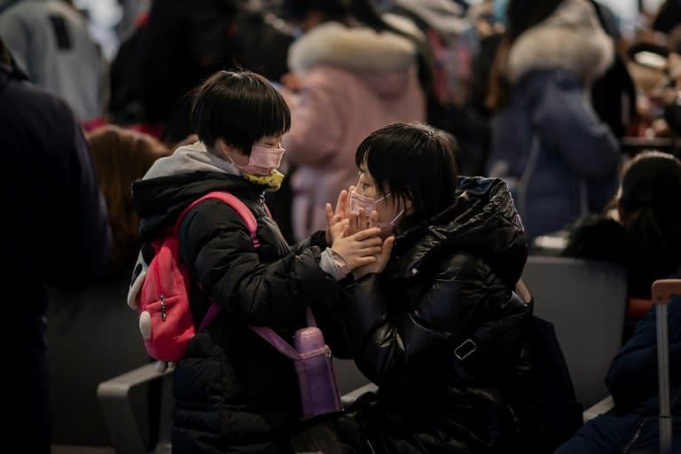 China's coronavirus death toll rises to 213, health officials say