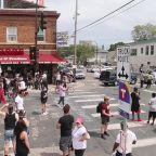 Demonstrators take to street corner in Minneapolis where George Floyd died