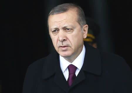 Turkey's President Tayyip Erdogan arrives for a welcoming ceremony at the Presidential Palace in Ankara