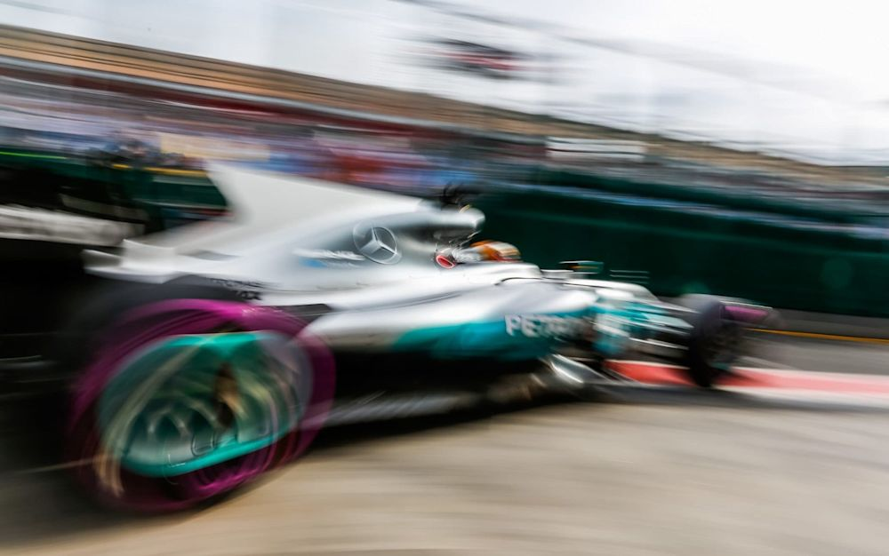 Lewis Hamilton exits the pit lane during Friday free practice at the Australian Grand Prix - Rex Features