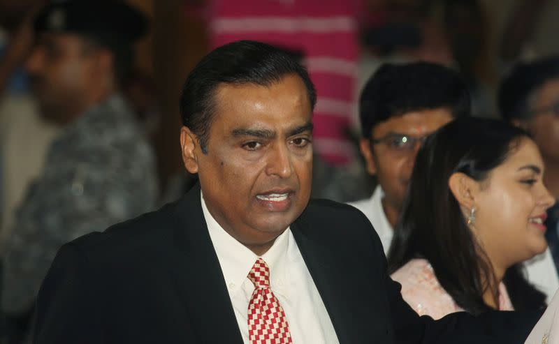 FILE PHOTO: Mukesh Ambani, Chairman and Managing Director of Reliance Industries, attends the company's annual general meeting in Mumbai
